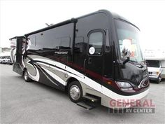 New 2014 Coachmen RV Sportscoach Cross Country 360DL Motor Home Class A - Diesel at General RV   North Canton, OH   #108410  Sportscoach Cross Country Class A Diesel Coach w/Rear Queen Bed Including: Nightstand & Storage Cabinet, Wardrobe Slide, Side Aisle Bath w/Shower, Toilet & Sink, L-Sofa & Booth Dinette Slide w/Overhead Storage Above Sofa, Refrig., 3 Burner Range, Dbl. Kitchen Sink, LCD TV & Much More!