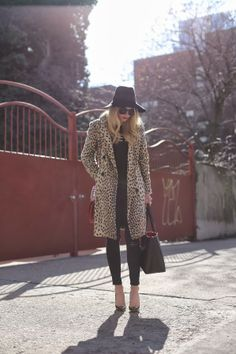 The perfect leopard print coat. But the whole look is great. 60's beatnick meets 70's glam.
