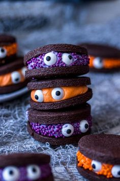 These Halloween cookies are made with a chocolatey cookie and a vanilla buttercream filling. #halloween #recipes #food #triedit #halloweenrecipes #halloweensnacks