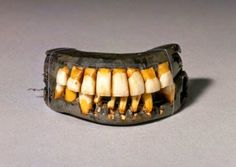 These are George Washington's dentures. Do you notice the missing tooth on the bottom right? This was because when the dentures were made he still had one natural tooth remaining and the dentures were made around it. This is what is called a partial denture. My how things have changed!