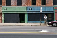Empty store fronts opposite the east side of Kodak Office... I was never sure why this dilapated row of mostly empty stores were getting new windows slowly put in on each floor...  Perhaps their competition was evesdropping?  The old bar, Magnolias, was at the North end and closed about 20 years ago.   By 2000, toward the south end there was a florist, a jeweler, a small restraunt and a Sub shop... until finally just the Sub shop was open
