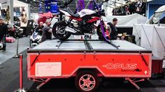 You want to go camping with the family, but you also want to sneak out and bike a bit of the enticing weave of scenic roads just outside camp. For those trips, the new Opus Moto trailer packs a comfortable folding tent with a trailer-top motorcycle carrier and lift system.