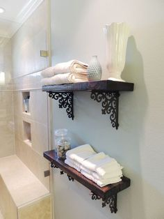 Dress up bathroom walls with shelves made of stained wood and decorative brackets.