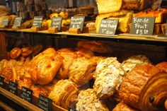 Love display cases full of flakey pastries and hand written price tags. also croissant bread pudding? Bread Pudding With Croissants, Croissant Bread, Bakery Cafe, Bakery Logo, Cafe Bar, Coffee Shop Signs, Pastry Display, Displays, Bonjour