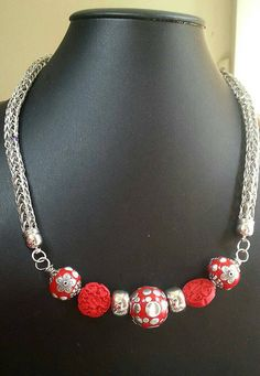 Check out this item in my Etsy shop https://www.etsy.com/listing/232720815/double-viking-knit-necklace-with-red-and