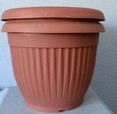 Gardening Diy how to upcycle cheap flower pots, container gardening, crafts, gardening, via Kristin My Uncommon Slice of Suburbia - Here Are 10 Gorgeous Designer Tricks for Your Dollar Store Pots- Transform your dollar store pots into some spectacular! Large Flower Pots, Plastic Flower Pots, Plastic Planters, Flower Boxes, Modern Plant Stand, Diy Plant Stand, Dollar Store Crafts, Dollar Stores, Diy Gutters