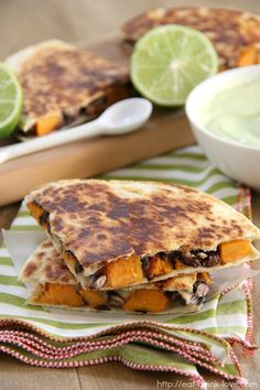 Sweet Potato and Black Bean Quesadillas: I'd probably make this into a burrito instead and nix the cheese.I want a Sweet Melissa's burrito basically Sweet Potato Burrito, Sweet Potato Quesadilla, Mexican Food Recipes, Vegetarian Recipes, Cooking Recipes, Vegan Dinners, Healthy Recipes, Game Day Food, Sweet Potato Recipes