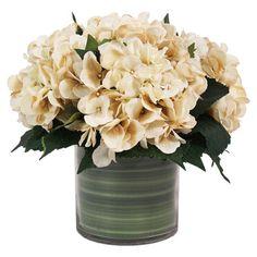 Faux hydrangea arrangement in a glass pot.   Product: Faux floral arrangementConstruction Material: Silk, plastic an...
