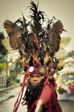 This man wear a War Uniform, and he doing a Minahasan War Dance called Kabasaran, is one of Culture that represents Indonesian Culture in Independence Carnival.