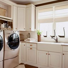 A farmhouse sink, raised-panel cabinetry and a neutral color palatte give this space cozy cottage charm.