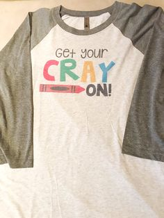 Get Your Cray On long sleeve raglan.  Fits true to size..a little on the looser side for some people. Reaches near the hips. Super soft and comfy.  The gray sleeve and gray collar raglan is shown. You can also choose a red color option.  Design is print transferred onto shirt.