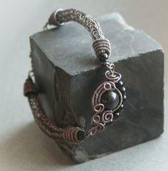 Eye of the Storm - viking knit copper wire bracelet with rainbow obsidian. $36.00, via Etsy.