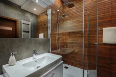 As such, bathroom upgrades can raise your house's resale value. Here are 4 bathroom renovations. Wooden Wall Bathroom, Bathroom Windows, Wooden Walls, Bathroom Repair, Frameless Shower Enclosures, Safe Room, Glass Shower, Bathroom Renovations, Bathroom Ideas