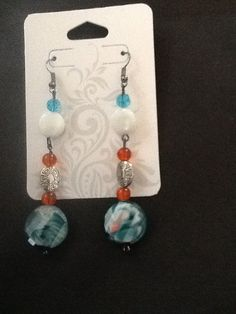 Hey, I found this really awesome Etsy listing at https://www.etsy.com/listing/191493087/turquoise-and-orange-dangle-earrings