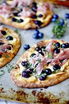 """Blueberry Pizza with Honeyed Goat Cheese and Prosciutto -- Naan bread and Trader Joe's Honey Goat Cheese logs make these """"mini pizzas"""" super easy to prepare. Love when sweet and savory come together in an unusual, gourmet way! I Love Food, Good Food, Yummy Food, Yummy Recipes, Prosciutto Pizza, Prosciutto Recipes, Do It Yourself Food, Calzone, Empanadas"""