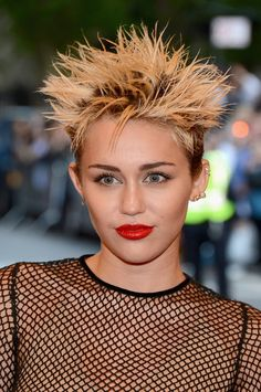 Miley Cyrus capitalized on her short hair to do the ultimate punk hairstyle: rock-and-roll spikes. #MetGala
