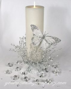 reception ceremony glittered silver confetti diamonds garland white centerpiece candle pillar unity candle feather butterfly