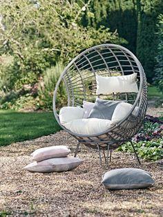 Made from durable materials that look just like light rattan, our impressive hanging chair has been intricately woven around a strong metal frame in a smooth egg shape. Big enough to snuggle up with a book and glass of wine, our stylish chair includes a sumptuously filled cream armchair seat cushion and headrest that are easily removable for storage and washing. A metal stand is also included to allow you the choice to either hang the chair or place this on the stand.  As seen in The Sunday…