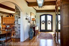 Another idea for jazzing up a cookie cutter condo -- www.fauxwoodbeams.com