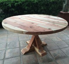 """My dad brought me a bunch of redwood that had been leftover from a deck he had built. It sat around for a while before I woke up one morning with a grand idea to build a table with it. I have never built anything out of wood before but have always wanted to! I … Continue reading """"Reader Showcase// AvocadoLvr's Round Provence Beam Dining Table"""""""