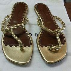 Manolo Blahnik gold sandal Gold leather lightly worn size 38.5. Bottom of shoe says 38.5 but they fit more like an American 7.5.  with duster bag Manolo Blahnik Shoes
