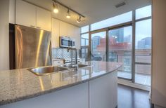 Toronto Lofts, Lofts For Rent, High Windows, Gas Bbq, Living Room Shelves, Art Deco Buildings, Wall Mounted Tv, Window Wall, Workout Rooms