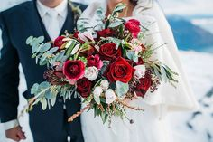 Red roses and ranunculus with white rose and greens