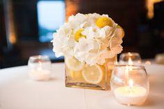 Love this simple flower arrangement incorporating lemons.