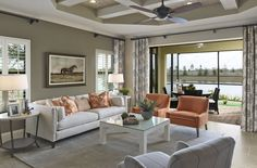 Crystal Sand living room in neutrals and muted coral, with the perfect outdoor view! Contact Neal Communities to view their new builds in FishHawkRanch.