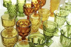 Vintage amber and green glassware is perfect for beer and other spirits! Scott Faber Photography - Southern Vintage Table