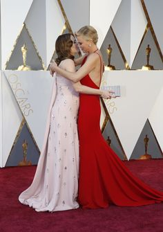 Emily Blunt and Charlize Theron arrive on the Oscars red carpet for the 88th Academy Awards.