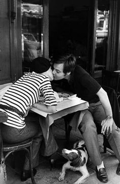 """Done by the French photographer Henri Cartier-Bression; this kiss was done in """"Le Quartier Latin"""" in Paris"""