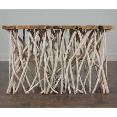 This console table exhibits a modern contemporary design. The branching coral legs add complementing natural touches. This eco-friendly design will give any décor a natural look to any space.