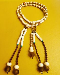 SGI Prayer Beads, Juzu Beads, are made of bone, brass and African recycled glass.