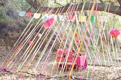 Streamers draped over a tree branch make a colorful tent (via apartment therapy)