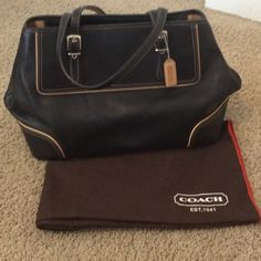 Coach black leather Carryall Bag Coach black smooth leather carry all bag with tan trim. Inside zip, cell phone and multifunction pockets. Zip closure and fabric lining Coach Bags Shoulder Bags