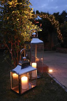 Large and medium coach lanterns plus warm white pealights at Northbrook Park Farnham by www.stressfreehire.com #venuetransformers