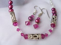 Elegant deep burgundy freshwater pearls and Swarovski crystal necklace and earring set with metal accents by SparkleandComfort, $12.99