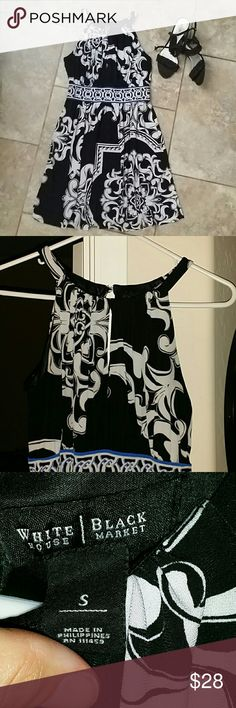 """WHITE HOUSE BLACK MARKET DRESS From work to play, gorgeous black and white dress with royal blue trim at empire waist. 4.5"""" keyhole at neck in both from and back, best seen in pic #2. 32"""" in length from center if neckline. Shell is 95% polyester and 5% spandex. Lining is 100% polyester. Machine wash. Let me know if more pics are wanted. No rips, stains or pilling. Smoke free home. White House Black Market Dresses"""