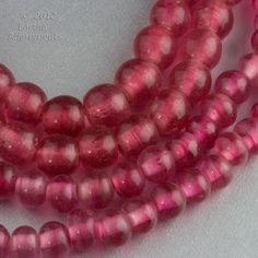 Chinese Peking glass beads in a translucent dark rose