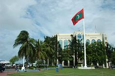 Male's central square with the giant flagpole and the Shaheed Hussain Adam Building in the background, Male. Capital Of Maldives, Maldives Tourism, Kings Island, Indian Navy, Island Nations, Small Island, Archipelago, Dream Vacations, Dolores Park