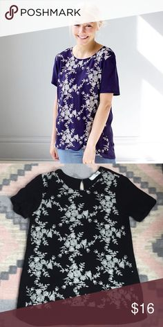 Embroidered Flower Top Adorable top with white flower embroidery. The back has a small button with an elastic loop with a small keyhole. Model is in blue, my shirt (second picture) is black! Size medium but fits more like a small. Ovi Tops Blouses