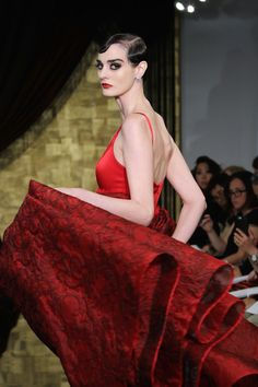 A crimson Theia gown with a damask skirt.