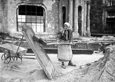 The Trummerfrauen phenomenon was launched by Allied orders requiring women between the ages of 15 and 50 to report for duty. A law passed by the military government allowing local authorities to employ women in clearing rubble. Here, a woman sifts sand in bombed out Berlin in 1948.