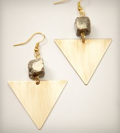 Capri Earrings | Two-inch brass triangles hang from rugged pyrite cubes.
