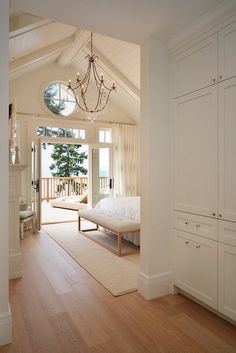 My bedroom will have cathedral ceilings like this and big windows in front.  I like how light and airy this is.