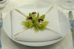 Napkin fold with orchid