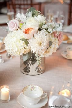 mercury glass vase filled with blushed centerpiece. Juliette garden roses with dahlias and hydrangea. Beautiful!