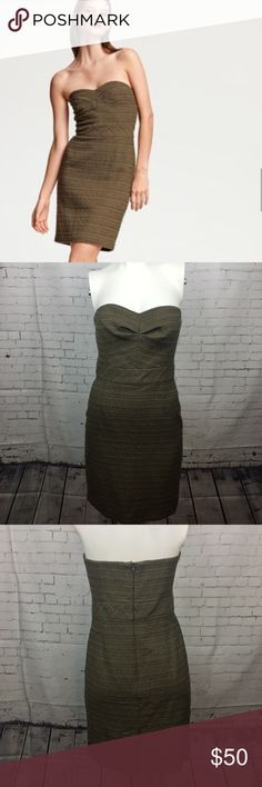 "Trina Turk Cora Tweed Strapless Mini Dress Empire Excellent used condition, without flaws.   Gorgeous designer dress with an empire waist and structured bust. Zips up the back and has a sticky strip to hold the dress in place along the top. Tweed material with greens and browns. ""Cora"" style.  32"" bust, 28"" long. Trina Turk Dresses Mini"