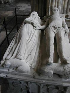 "Tomb effigy - Richard FitzAlan, 10th Earl of Arundel and 8th Earl of Surrey & Eleanor Plantagenet - Chichester Cathedral, West Sussex, England. In his will, Richard requested to be buried ""near to the tomb of Eleanor de Lancaster, my wife; and I desire that my tomb be no higher than hers, that no men at arms, horses, hearse, or other pomp, be used at my funeral, but only five torches...as was about the corpse of my wife, be allowed."""